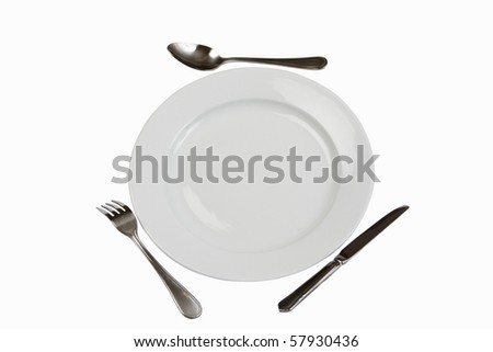 Place Setting with Plate, Knife, Fork & Spoon A white china plate with silver knife,fork and spoon. Clipping path included. - stock photo