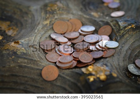 Place the coin on the Buddha's footprint model. Religious beliefs - stock photo