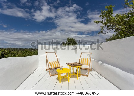 Place to relax on a porch on vacation. A board game on the table. - stock photo
