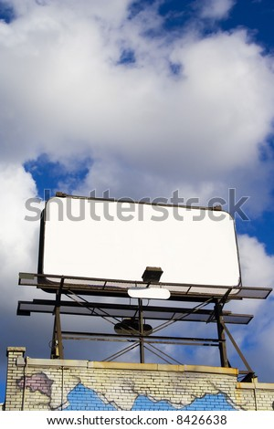 Place your text here - empty ad space in the sky with clouds and brick wall in Downtown Toronto - stock photo