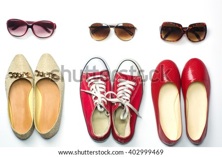 Placed shoes and sunglasses on a white background styles - lifestyles - stock photo
