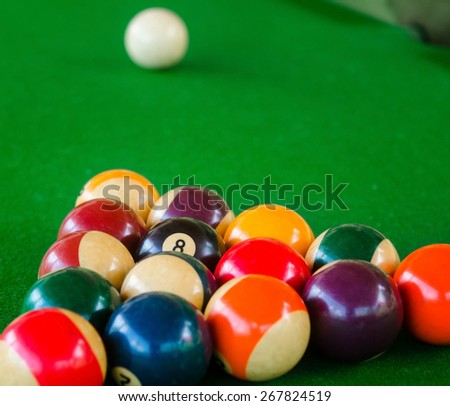 Placement of billiard balls on the table before the game. Focus on the black ball - stock photo