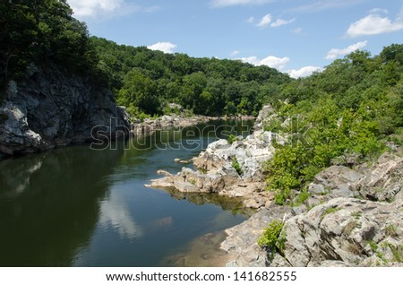 Placid water at Great Falls Virginia with the sky reflected - stock photo