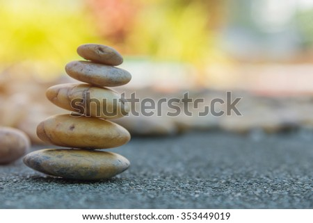 placing the stone stack on a rock.