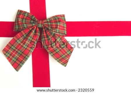 Plaid bow and red ribbon on white background - stock photo