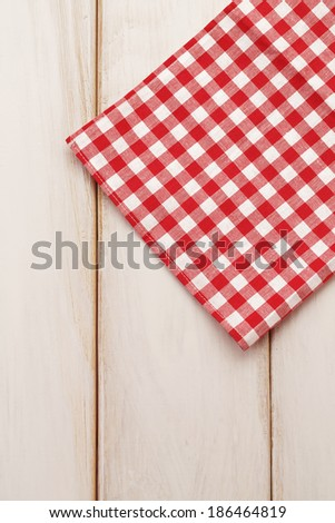 Plaid cloth on picnic table/Picnic table background