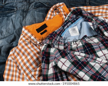 plaid shirt and denim jeans as a background - stock photo