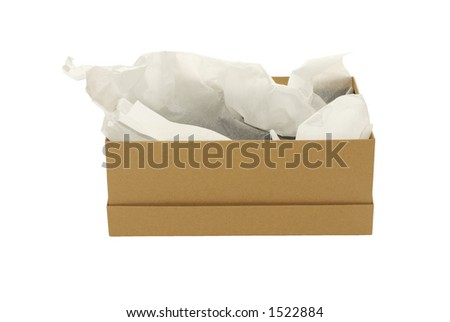 Plain brown shoe box with tissue paper - stock photo