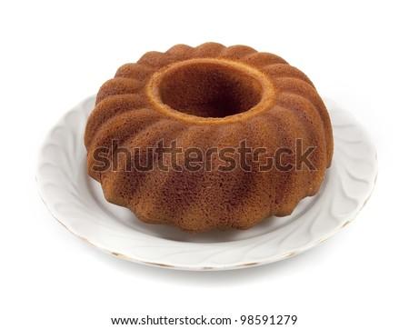 Plain cake on a dish isolated white background - stock photo