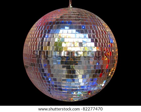 Plain disco ball isolated in black - stock photo
