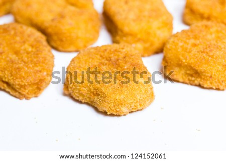 plain isolated chicken nuggets - stock photo