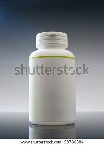 Plain plastic medicine container on white background - stock photo