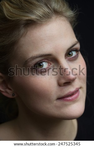 plain portrait of a  beautiful young blond woman