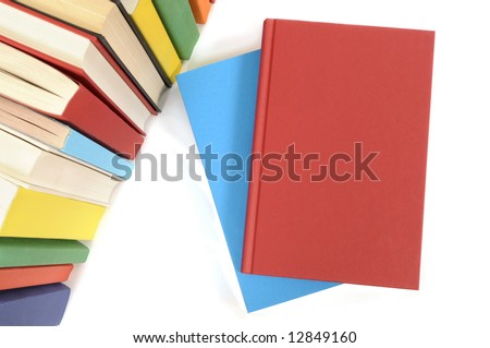 Plain red book with row of colorful books isolated on a white background.  Space for copy. - stock photo