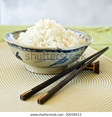 plain ricein an old chienes ceramic bowl - stock photo