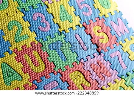 Plain white jigsaw puzzle, on Blue background, autism awarness symbol - stock photo