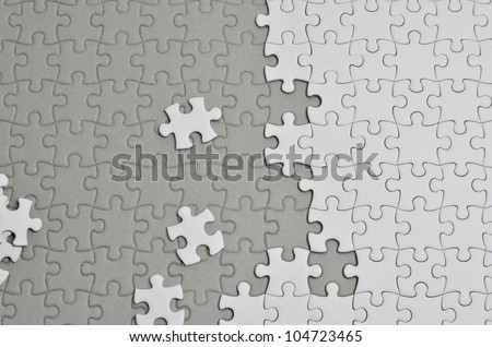 Plain white jigsaw puzzle, on Gray background.