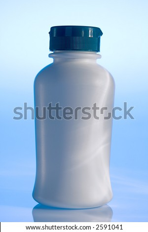Plain white plastic pill bottle on blue - stock photo
