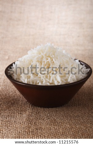 plain white rice bowl  on brown rustic background, Low Key Lighting Technique, Shallow DOF