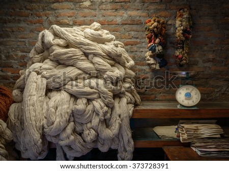 Plain wool before dyeing in a rug factory - stock photo
