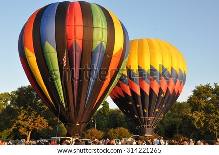 PLAINVILLE, CT - AUG 29: Balloon launch at dawn at the 2015 Plainville Fire Company Hot Air Balloon Festival held from August 28-30, 2015. Thousands of people attended this festival in its 31st year.