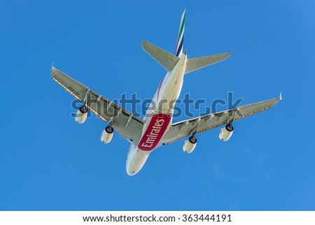 PLAISANCE, MAURITIUS - DECEMBER 27, 2015: The Airbus A380 aircraft of Emirates Airlines takeoff from the Sir Seewoosagur Ramgoolam Int Airport, Plaisance, Mauritius, and flying to Dubai. - stock photo