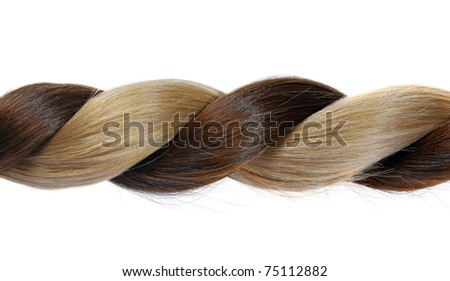 plait from natural brown and blond hair on a white background