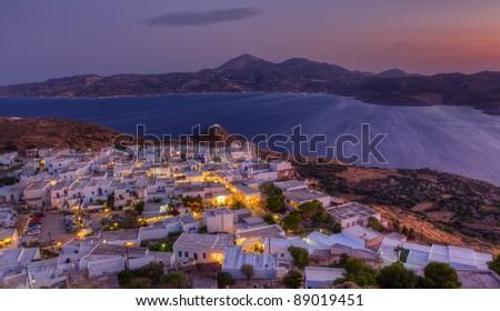 Plaka village dusk panorama, Milos island, Cyclades, Greece - stock photo