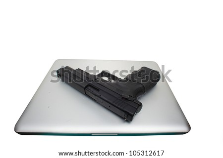 Plan B/Autoloader handgun sitting atop aluminum body notebook computer.