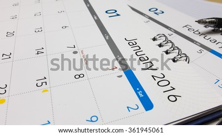 Plan for New Year 2016, Calendar of 2016 with Pen and Notebook on Office Desk