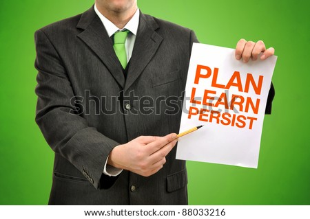 Plan, learn,persist concept, businessman holding paper with printed marketing terminology.