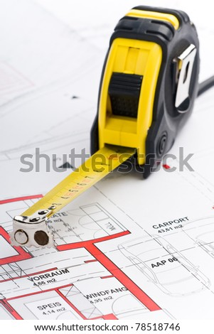 plan of a house with a pocket rule - stock photo