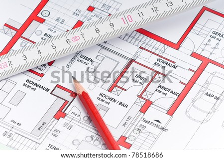 plan of a house with a ruler and a red pencil - stock photo