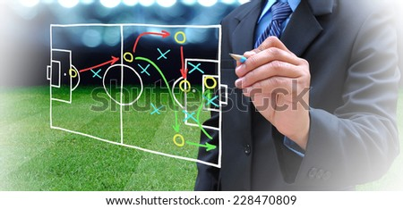 plan of soccer manager at soccer field  - stock photo