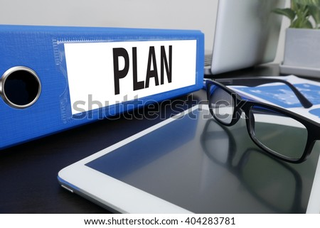 Plan Planning Concept Office folder on Desktop on table with Office Supplies. ipad - stock photo