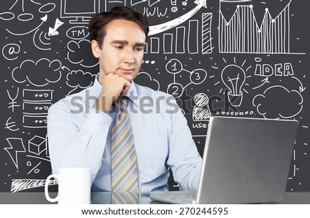 Plan. Pretty young businesswoman sitting at desk with business scheme and icons - stock photo