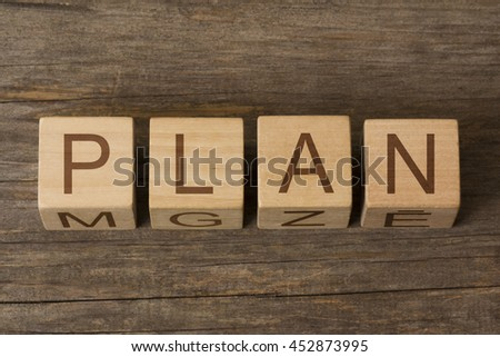 PLAN word on wooden cubes - stock photo