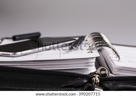 plan your future and business - calendar, planner, cellphone and pen - stock photo