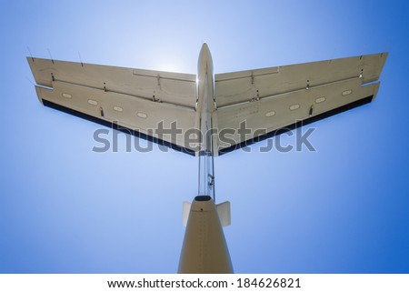 Plane Aircraft Tail Wing Blue Back of prop aircraft tail wing in blue sky - stock photo
