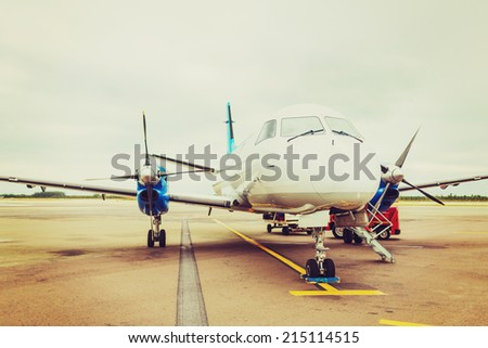 plane, airport, tourism and transportation concept - plane on runway at airport - stock photo