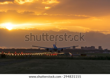 Plane almost landed at the runway. Engine heat behind the plane. - stock photo