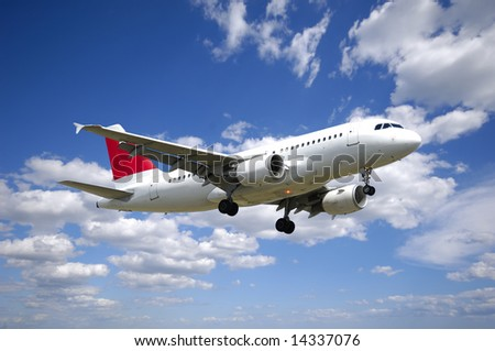 Plane and cloudscape and blue sky - stock photo