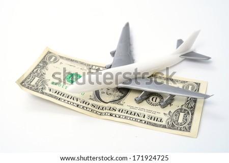 plane and money on  white background  - stock photo
