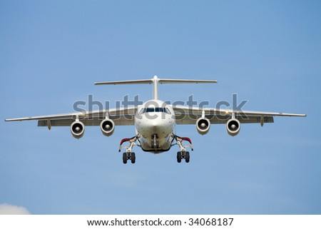 Plane approaching for landing - stock photo