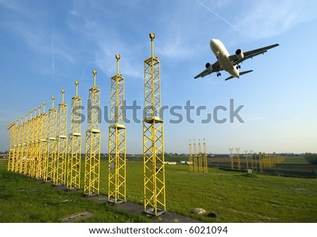 Plane approaching runway - stock photo