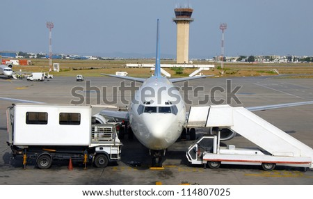 Plane at airport - stock photo