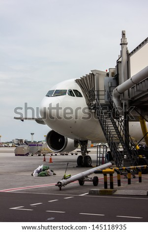 Plane at international airport - stock photo