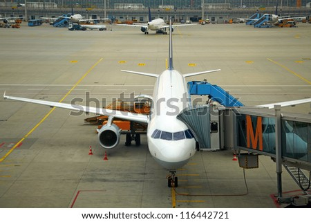 Plane at the airport - stock photo