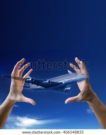 plane between the hands, Airline flight insurance - stock photo