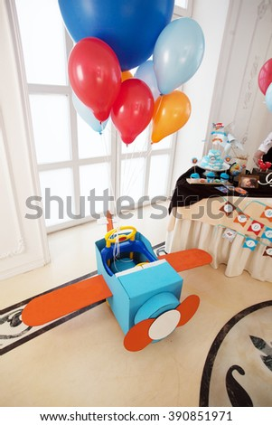 plane cardboard child childhood joy orange blue balls - stock photo